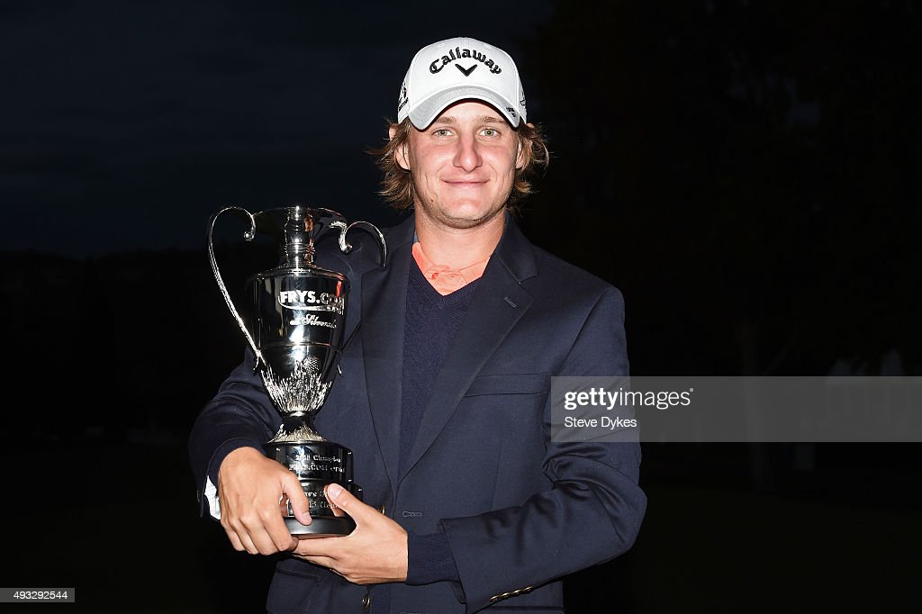 Emiliano Grillo of Argentina celebrates with the trophy after winning in the final round of the Frys.com Open on October 18, 2015 at the North Course of the Silverado Resort and Spa in Napa, California.