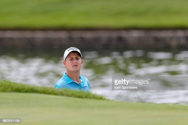 Emiliano Grillo of Argentina looks on after hitting from the green side bunker on during the second round of the Fort Worth Invitational on May 25...