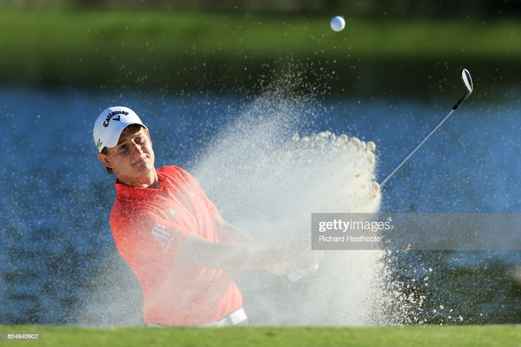 Emiliano Grillo of Argentina plays a shot from a bunker on the 17th hole during the third round of the Arnold Palmer Invitational Presented By MasterCard at Bay Hill Club and Lodge on March 18, 2017 in Orlando, Florida.