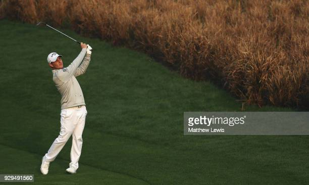 Emiliano Grillo of Argentina plays a shot from the 11th fairway during day two of the Hero Indian Open at Dlf Golf and Country Club on March 9, 2018...