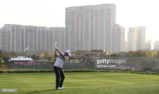 Emiliano Grillo of Argentina plays his second shot on the 18th hole during day one of the Hero Indian Open at Dlf Golf and Country Club on March 8,...