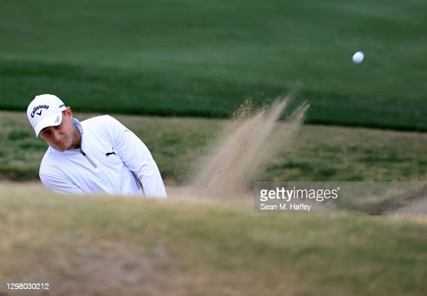 Emiliano Grillo of Argentina plays his shot from the 18th tee during the third round of The American Express tournament on the Stadium course at PGA...