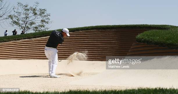 Emiliano Grillo of Argentina plays out of a bunker on the 4th hole during day three of the Hero Indian Open at Dlf Golf and Country Club on March 10,...