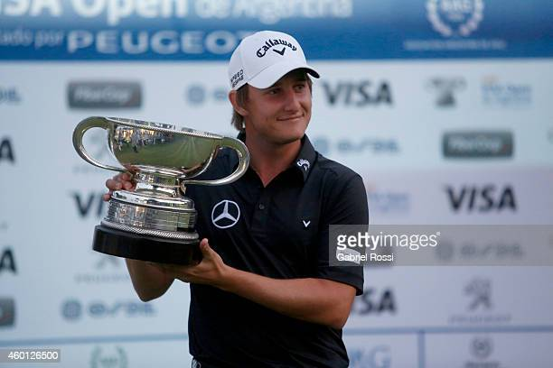 Emiliano Grillo of Argentina poses for a photo with his trophy after winning the 109th VISA Open Argentina as part of PGA Latinoamerica tour at...