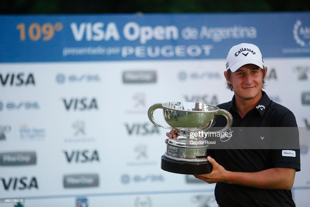 Emiliano Grillo of Argentina poses for a photo with his trophy after winning the 109th VISA Open Argentina as part of PGA Latinoamerica tour at Martindale Country Club on December 07, 2014 in Buenos Aires, Argentina.