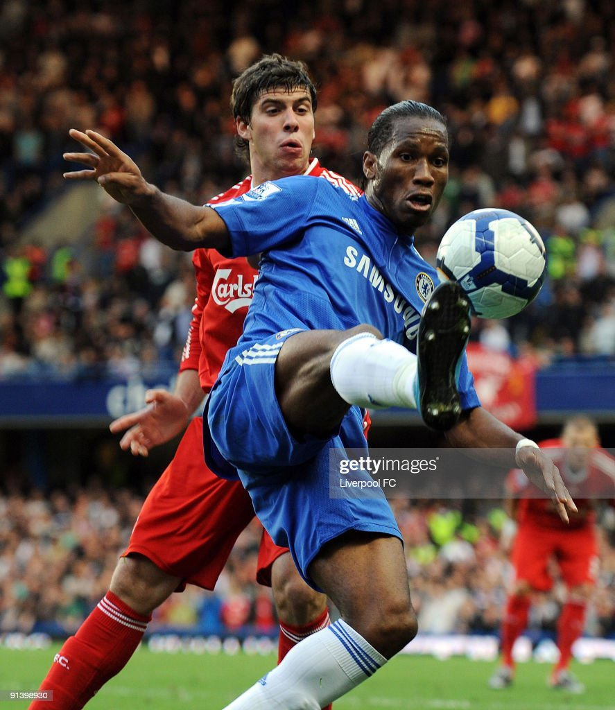 Emiliano Insua of Liverpool competes with Didier Drogba of Chelsea during the Barclays Premier League match between Chelsea and Liverpool at Stamford Bridge on October 4, 2009 in London, England.