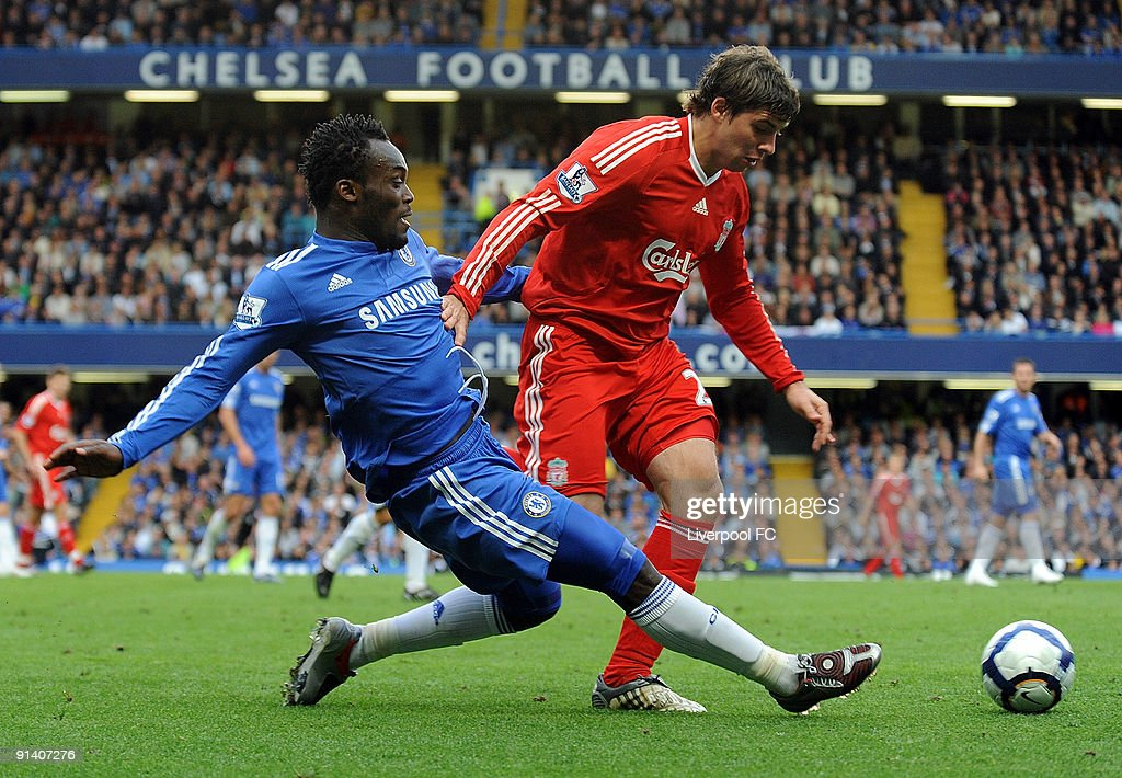 Emiliano Insua of Liverpool competes with Michael Essien of Chelsea during the Barclays Premier League match between Chelsea and Liverpool at Stamford Bridge on October 4, 2009 in London, England.