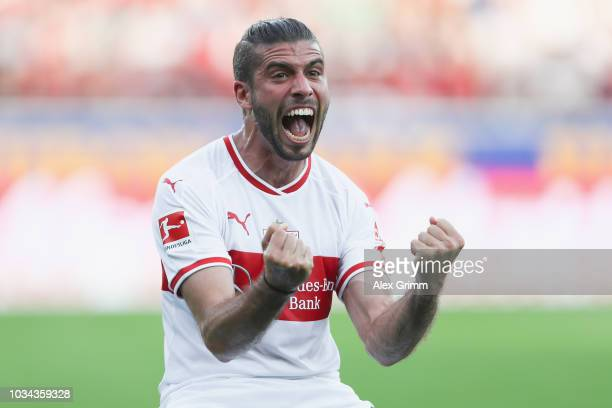 Emiliano Insua of Stuttgart celebrates his team's first goal during the Bundesliga match between SportClub Freiburg and VfB Stuttgart at...