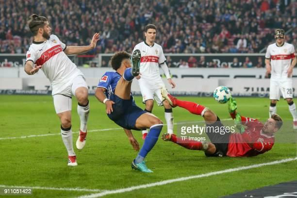 Emiliano Insua of Stuttgart RonRobert Zieler of Stuttgart and Thilo Kehrer of Schalke battle for the ball during the Bundesliga match between VfB...