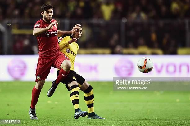 Emiliano Insua Zapata of VfB Stuttgart and Henrikh Mkhitaryan of Borussia Dortmund battle for the ball during the Bundesliga match between Borussia...