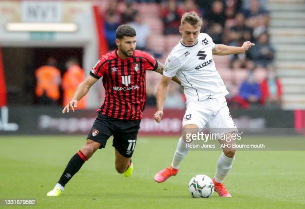 Emiliano Marcondes of Bournemouth closes down Scott Twine of MK Dons during the Carabao Cup 1st Round match between AFC Bournemouth and MK Dons at...