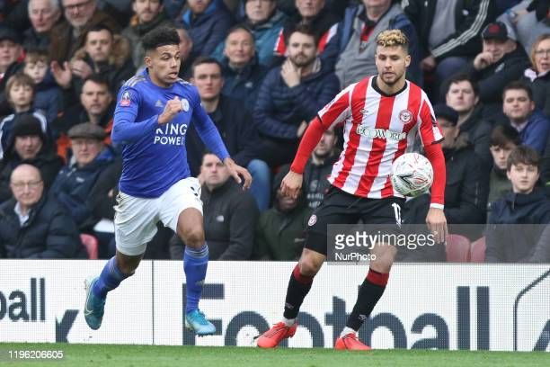 Emiliano Marcondes of Brentford and James Justin of Leicester City going for the ball during the FA Cup match between Brentford and Leicester City at...