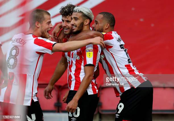 Emiliano Marcondes of Brentford celebrate with his team mates after he scores his team's second goal during the Sky Bet Championship Play Off...