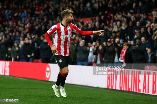 Emiliano Marcondes of Brentford celebrates after scoring his team's first goal during the FA Cup Third Round match between Brentford FC and Stoke...