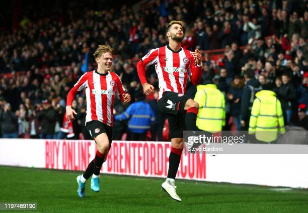 Emiliano Marcondes of Brentford celebrates with teammate Jan Zamburek after scoring his team's first goal during the FA Cup Third Round match between...