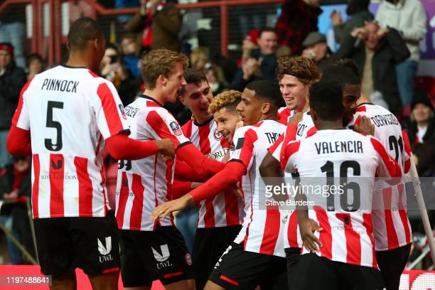 Emiliano Marcondes of Brentford celebrates with teammates after scoring his team's first goal during the FA Cup Third Round match between Brentford...