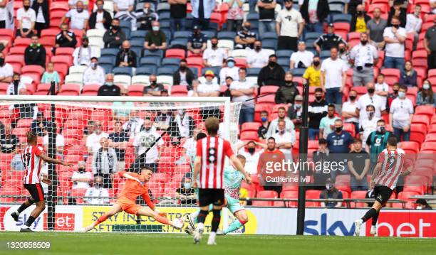 Emiliano Marcondes of Brentford scores his team's second goal during the Sky Bet Championship Play-off Final between Brentford FC and Swansea City at...