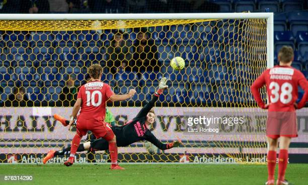 Emiliano Marcondes of FC Nordsjalland scores the 14 goal against Goalkeeper Frederik Ronnow of Brondby IF during the Danish Alka Superliga match...