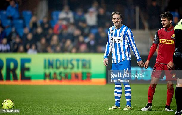 Emiliano Marcondes of FC Nordsjalland shares a joke with Nicki Bille Nielsen of Esbjerg fB before a penalty during the Danish Alka Superliga match...