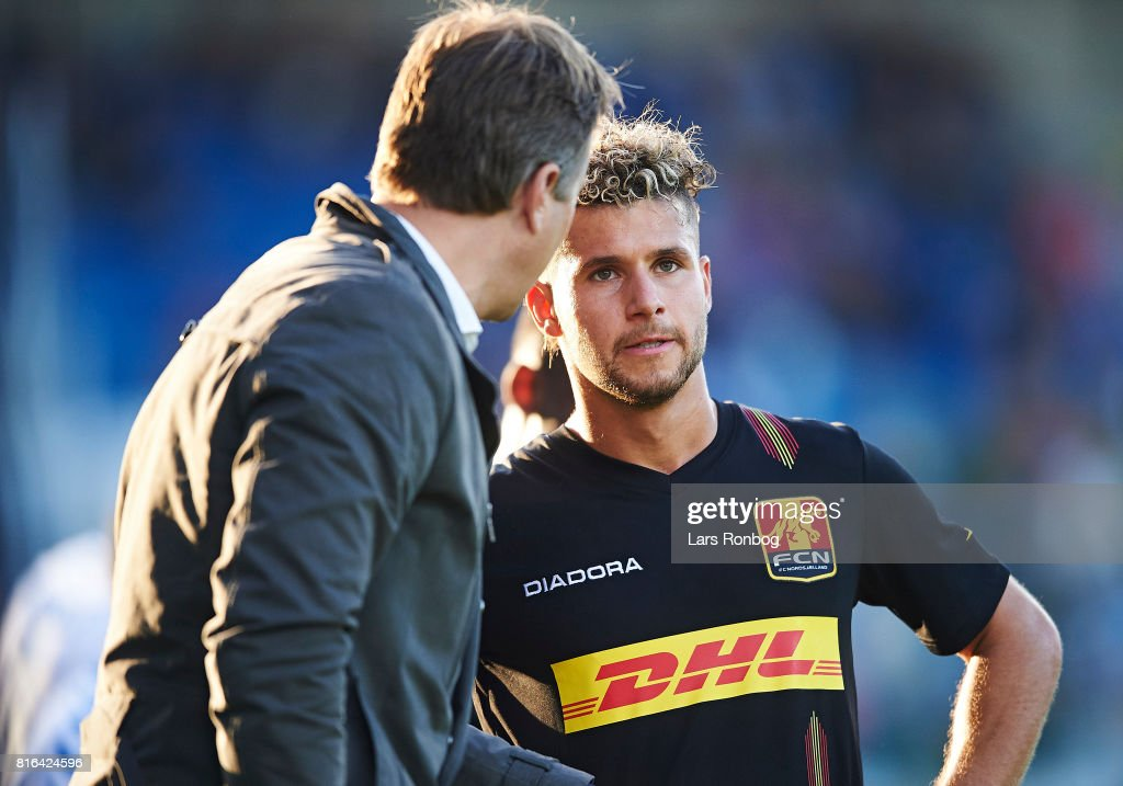 Emiliano Marcondes of FC Nordsjalland speaks to Kasper Hjulmand, head coach of FC Nordsjalland during the Danish Alka Superliga match between OB Odense and FC Nordsjalland at EWII Park on July 17, 2017 in Odense, Denmark.
