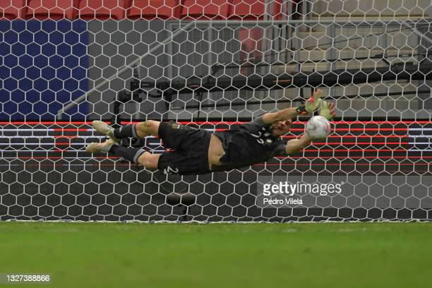Emiliano Martinez goalkeeper of Argentina dives to save penalty kick by Davinson Sanchez of Colombia in a shootout after a semi-final match of Copa...