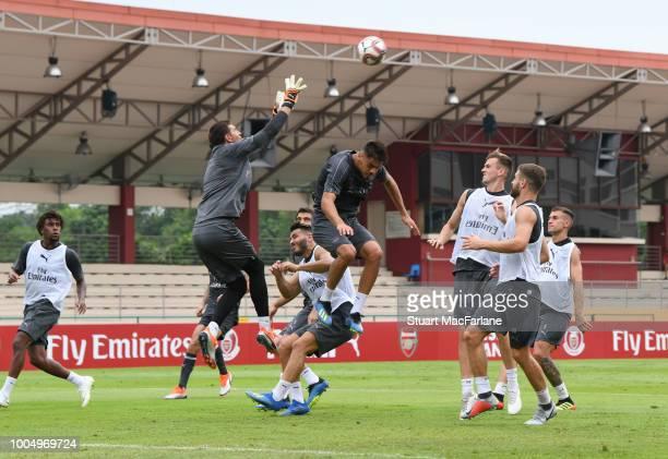 Emiliano Martinez Konstantinos Mavropanos Rob Holding and Shkodran Mustafi of Arsenal during a training session at Singapore American School on July...