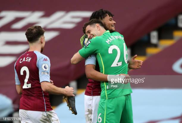 Emiliano Martinez of Aston Villa and Tyrone Mings of Aston Villa embrace after the Premier League match between Aston Villa and Fulham at Villa Park...