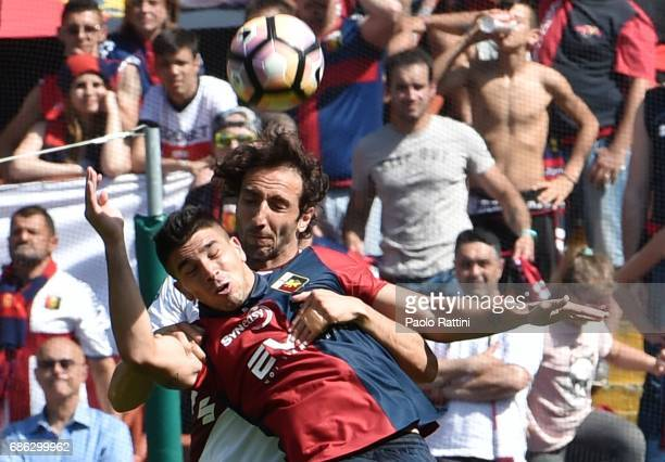 Emiliano Moretti of FC Torino and Giovanni Simeone of Genoa CFC during the Serie A match between Genoa CFC and FC Torino at Stadio Luigi Ferraris on...