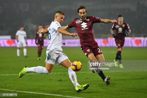 Emiliano Moretti of Torino FC competes for the ball with Miha Zajc of Empoli during the Serie A match between Torino FC and Empoli at Stadio Olimpico...