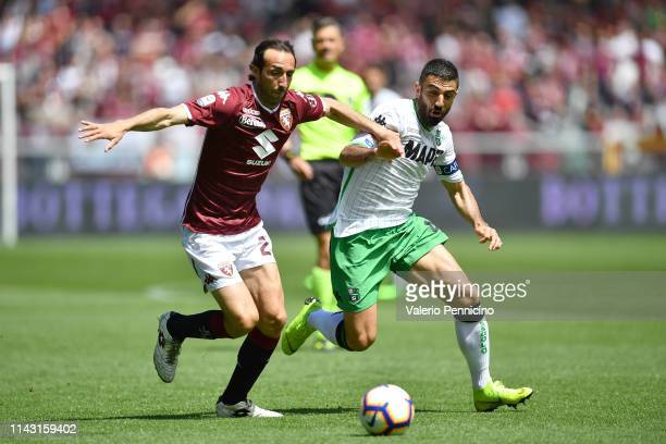 Emiliano Moretti of Torino FC is challenged by Francesco Magnanelli of US Sassuolo during the Serie A match between Torino FC and US Sassuolo at...