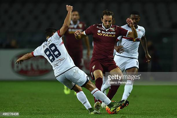 Emiliano Moretti of Torino FC is tackled by Tomas Rincon of Genoa CFC during the Serie A match between Torino FC and Genoa CFC at Stadio Olimpico di...
