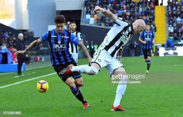 Emiliano Rigoni of Atalanta BC competes for the ball with Bram Nuytinck of Udinese Calcio during the Serie A match between Udinese and Atalanta BC at...