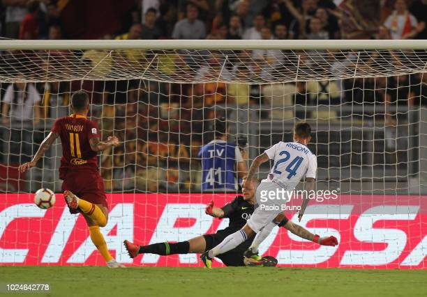 Emiliano Rigoni of Atalanta BC scores the team's second goal during the Serie A match between AS Roma and Atalanta BC at Stadio Olimpico on August 27...