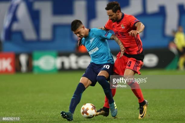 Emiliano Rigoni of FC Zenit Saint Petersburg and Alberto de la Bella of FC Real Sociedad vie for the ball during the UEFA Europa League Group L...