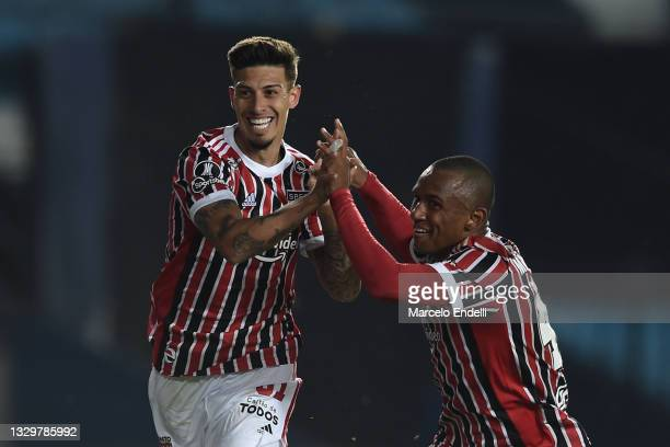 Emiliano Rigoni of Sao Paulo celebrates with Marquinhos of Sao Paulo after scoring the opening goal during a round of sixteen second leg match...