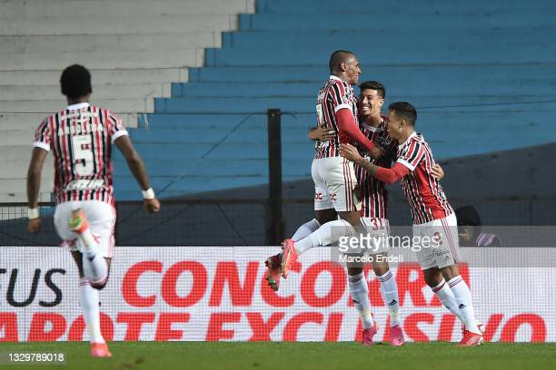 Emiliano Rigoni of Sao Paulo celebrates with teammates after scoring the third goal of his team during a round of sixteen second leg match between...