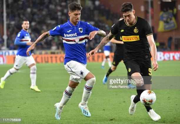 Emiliano Rigoni of UC Sampdoria and Alessandro Bastoni of FC Internazionale compete for the ball during the Serie A match between UC Sampdoria and FC...