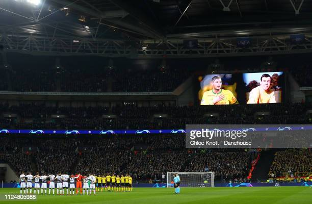 Emiliano Sala and Gordan Banks are shown on the stadium screen during a minute silence during the UEFA Champions League Round of 16 First Leg match...