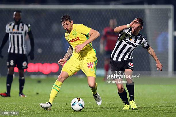 Emiliano Sala of Nantes and Baptiste Santamaria of Angers during the French Ligue 1 match between Angers and Nantes on December 16 2016 in Angers...