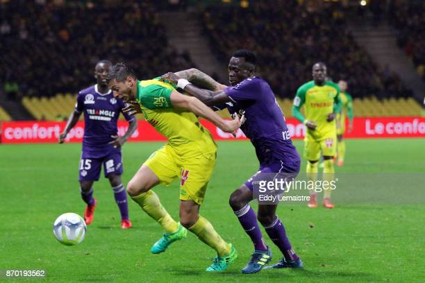 Emiliano Sala of Nantes and Issiaga Sylla of Toulouse during the Ligue 1 match between Nantes and Toulouse at Stade de la Beaujoire on November 4...