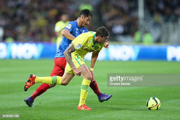 Emiliano Sala of Nantes and Nicolas Seube of Caen during the Football french Ligue 1 match between FC Nantes and SM Caen at Stade de la Beaujoire on...