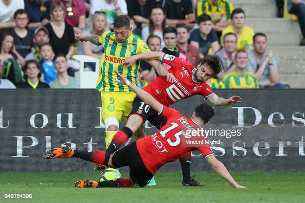 Emiliano Sala of Nantes and Rami Bensebaini and Sanjin Prcic of Rennes during the Ligue 1 match between Nantes and Rennes at Stade de la Beaujoire on...