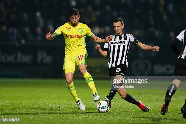 Emiliano Sala of Nantes and Romain Thomas of Angers during the French Ligue 1 match between Angers and Nantes on December 16 2016 in Angers France