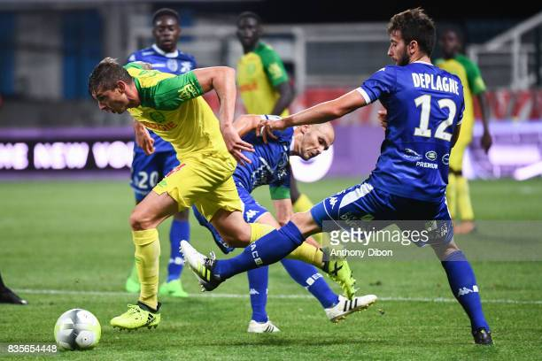 Emiliano Sala of Nantes between Benjamin Nivet and Mathieu Deplagne of Troyes during the Ligue 1 match between Troyes Estac and FC Nantes at Stade de...