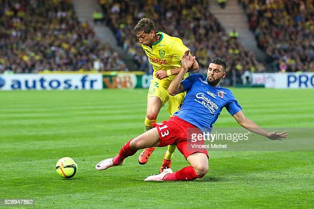 Emiliano Sala of Nantes is tackeld by Syam Ben Youssef of Caen during the Football french Ligue 1 match between FC Nantes and SM Caen at Stade de la...
