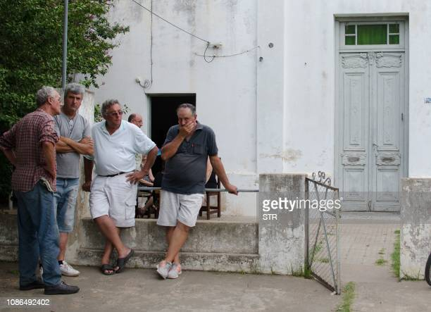 Emiliano Sala's father Horacio Sala speaks with friends in front of his house in Progreso Santa Fe province Argentina on January 22 2019 Premier...