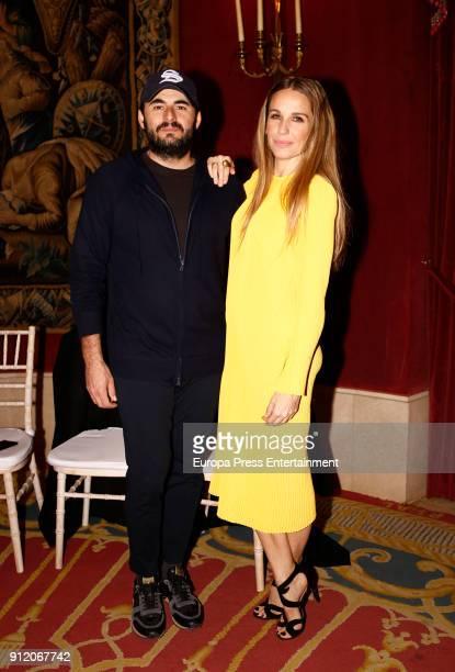 Emiliano Suarez and his wife Carola Baleztena attend the front row of Palomo Spain show during Mercedes Benz Fashion Week Madrid Autumn / Winter 2018...