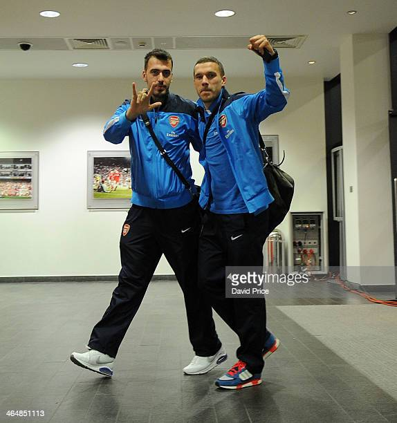 Emiliano Viviano and Lukas Podolski of Arsenal enters the stadium before the Arsenal against Coventry City FA Cup 4th Round match at Emirates Stadium...