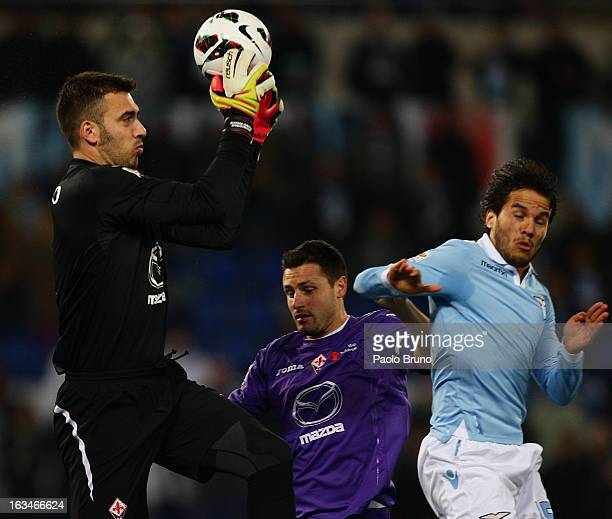 Emiliano Viviano and Rodriguez Gonzalo of ACF Fiorentina compete for the ball with Alvaro Gonzalez of SS Lazio during the Serie A match between SS...