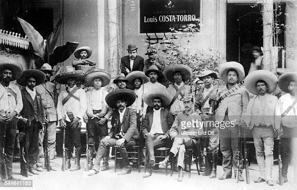 Emiliano ZAPATA Mexican revolutionary Zapata seated center with his men during the Mexican Revolution 1914